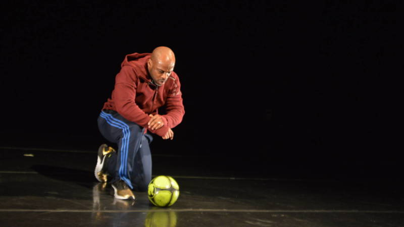 Marc Bamuthi Joseph dances with and then contemplates a soccer ball in his 'pen-LO-tah.'
