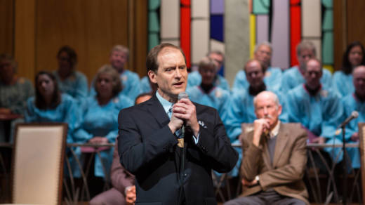 Pastor Paul (Anthony Fusco) preaches to his flock that they must make a radical change in Lucas Hnath's 'The Christians' at the San Francisco Playhouse.