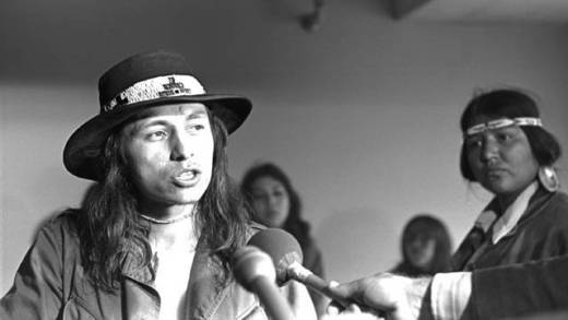 John Trudell, speaking at a press conference at Alcatraz during the occupation of 1969-1971. This photograph and others by Ilka Hartmann are on display as part of Cement Prairie, an exhibition about Native Americans in the South Bay.