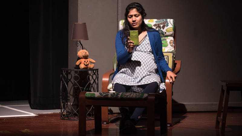 Priya Kumar, played by Devika Ashok, waits impatiently by the phone as her husband struggles to get back home in Airport Insecurity, produced by the Santa Clara-based theater company Naatak.