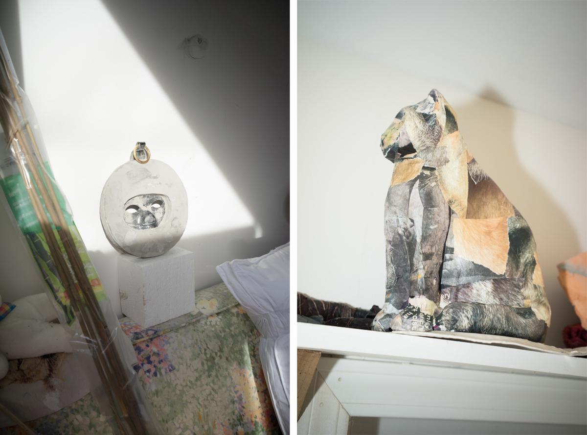 Concrete mask piece; a papier-mâché cat.