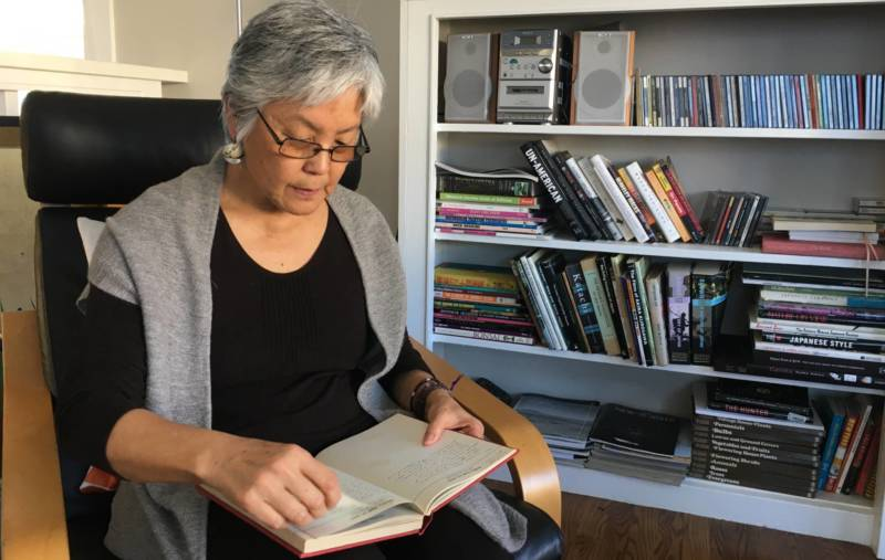 Satsuki Ina reads her mothers journal at home in Berkeley.
