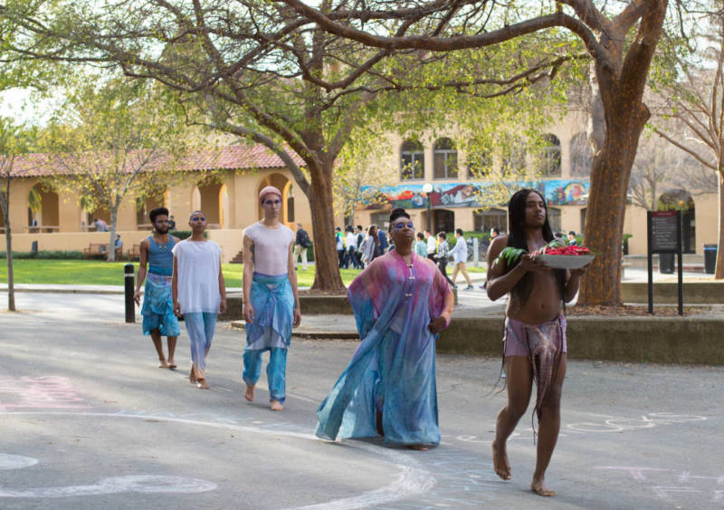 Unearthing performers marching through the Stanford campus.