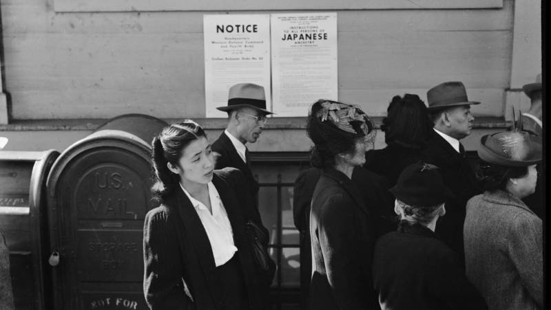 Shizuko Ina waits in line in San Francisco to hear news of her fate in the wake of President Franklin D. Roosevelt signing Executive Order 9066.