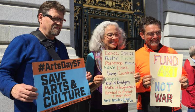 Signs at the rally for arts funding Wednesday at San Francisco City Hall