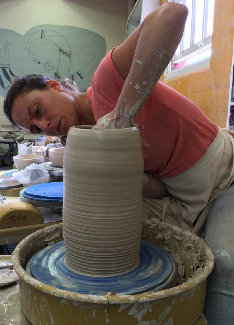 A City College of San Francisco student make a pot in ceramics class at the college's Fort Mason campus