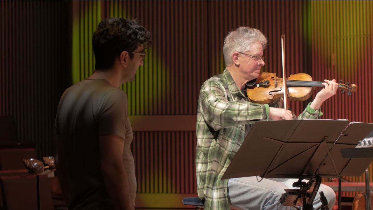 Sahba Aminikia in rehearsal with Kronos Quartet's David Harrington.