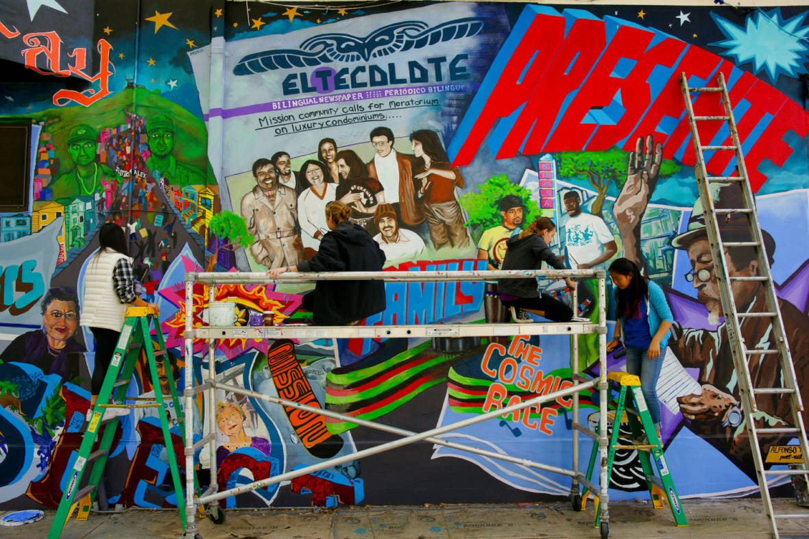 """This Place: A Tribute to the Mission Community,"" a 2015 mural by Precita Eyes muralists, photographed by Dick Evans.  Courtesy Dick Evans and Heyday Books"