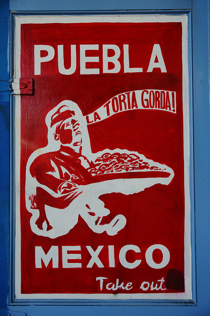 """Puebla Mexico Takeout"" sign photographed by Dick Evans."