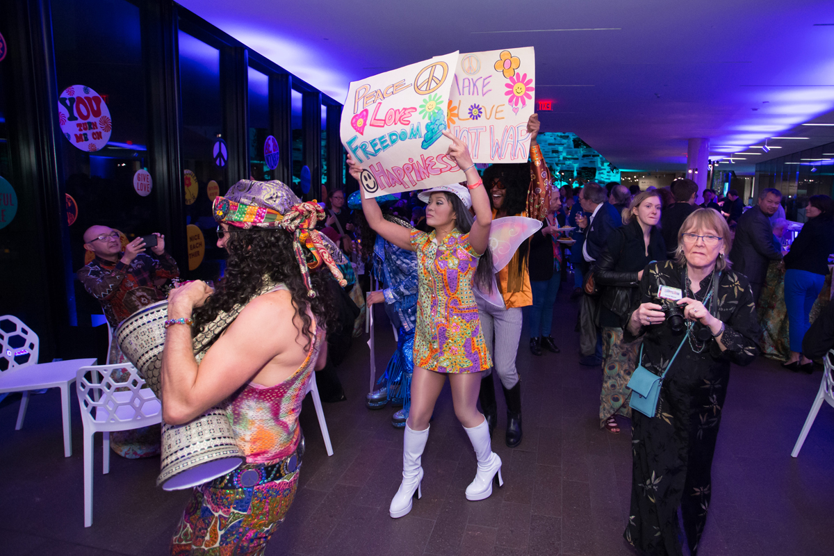 "Performers ""protesting"" at 'The Summer of Love Experience' donor reception at de Young Museum."