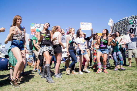 A crowd dances to a parody of Lorde's 'Royals' with lyrics about the environment at the People's Climate march in Oakland, April 29, 2017.
