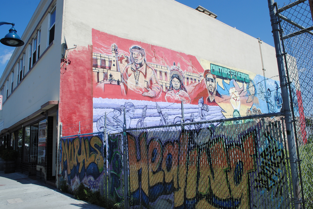 A mural on the building's exterior, at the corner of 23rd Avenue and International in Oakland.