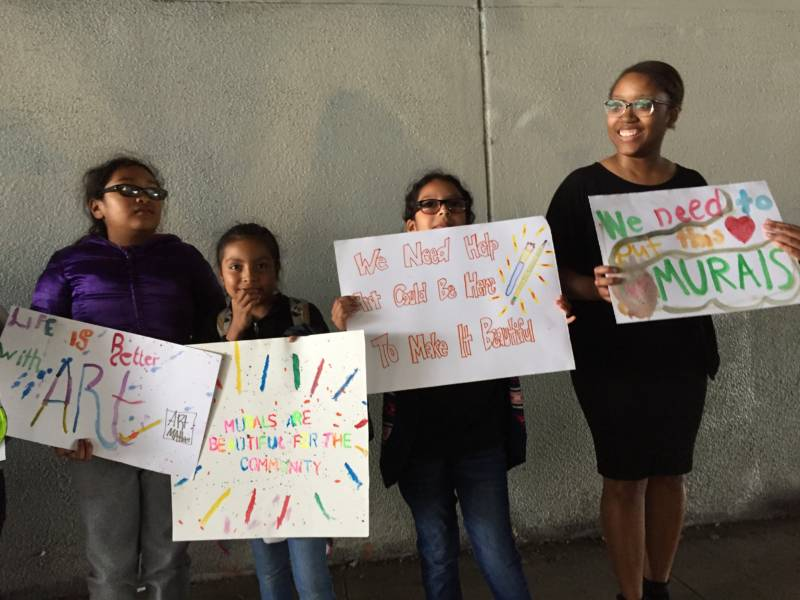 Hoover Elementary 4th graders protest a Caltrans policy holding up a new mural on a Highway 580 underpass