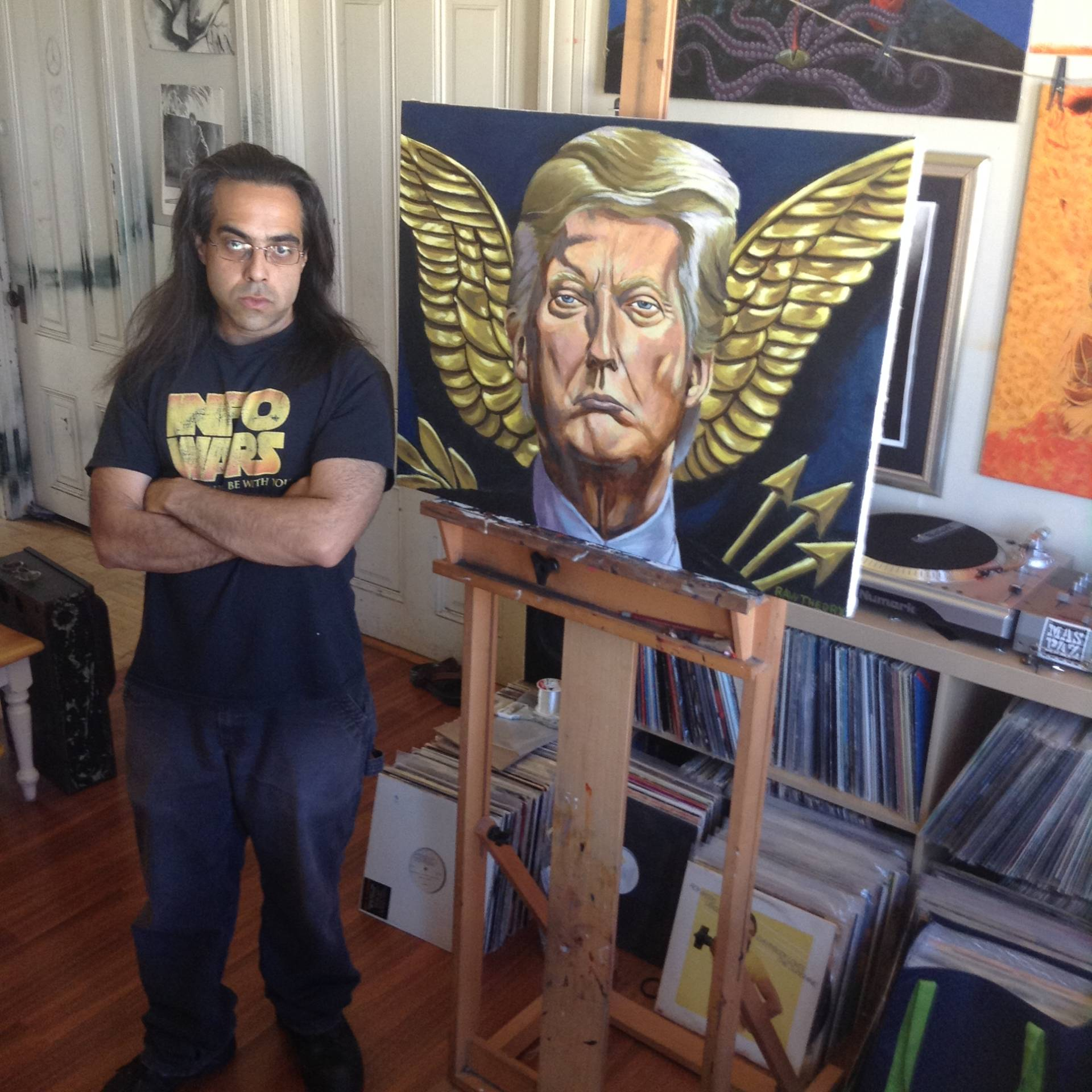 Oakland artist Jon Proby poses with his painting 'POTUS and me'.