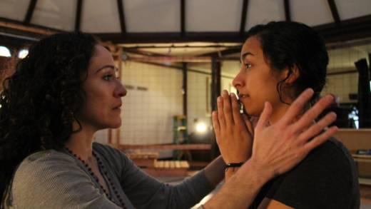 (L to R) Juana (Sarita Ocón) confronts the angelic Carmen (Carla Gallardo) in the Ubuntu Theater Project's production of 'To the Bone' by Lisa Ramirez.