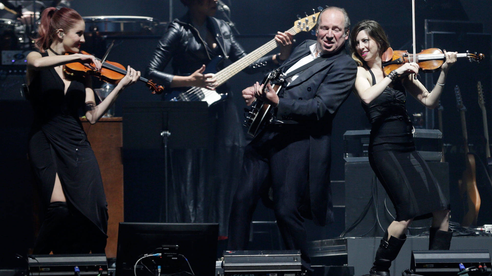 Hans Zimmer, on banjo, performs with members of his band at the Bill Graham Civic Auditorium in San Francisco on April 19, 2017. Photo: Gabe Meline/KQED