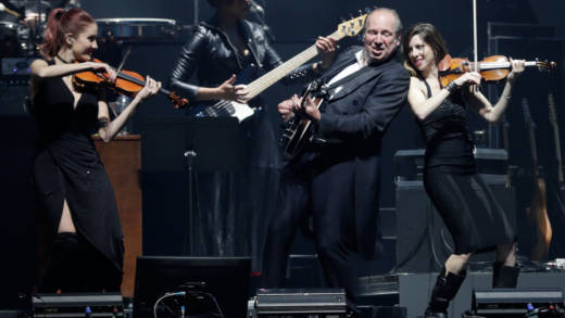 Hans Zimmer, on banjo, performs with members of his band at the Bill Graham Civic Auditorium in San Francisco on April 19, 2017.