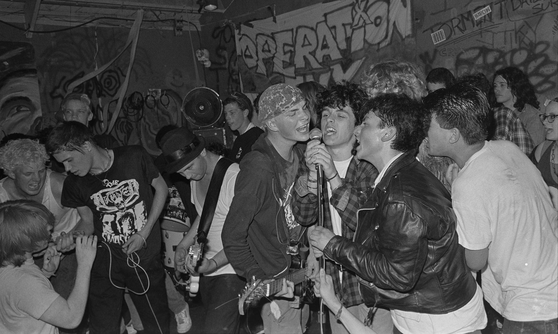 Billie Joe Armstrong (third from right) sings with Operation Ivy onstage at 924 Gilman, circa 1988.  Photo: Murray Bowles