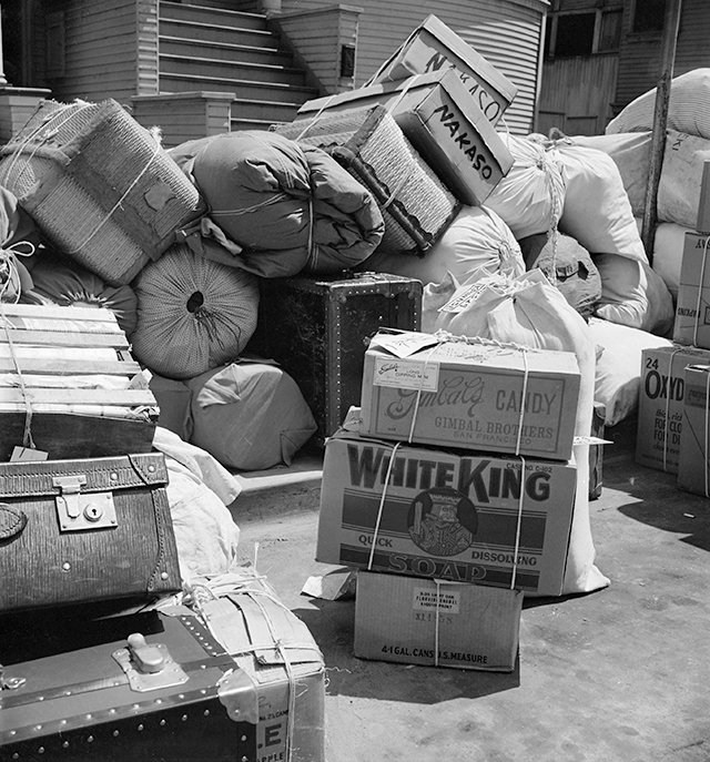 Dorothea Lange, 'Oakland, Calif. (1117 Oak Street)--Baggage belonging to evacuees of Japanese ancestry, ready to be loaded into moving vans to be taken to Tanforan Assembly Center, May 6, 1942.'