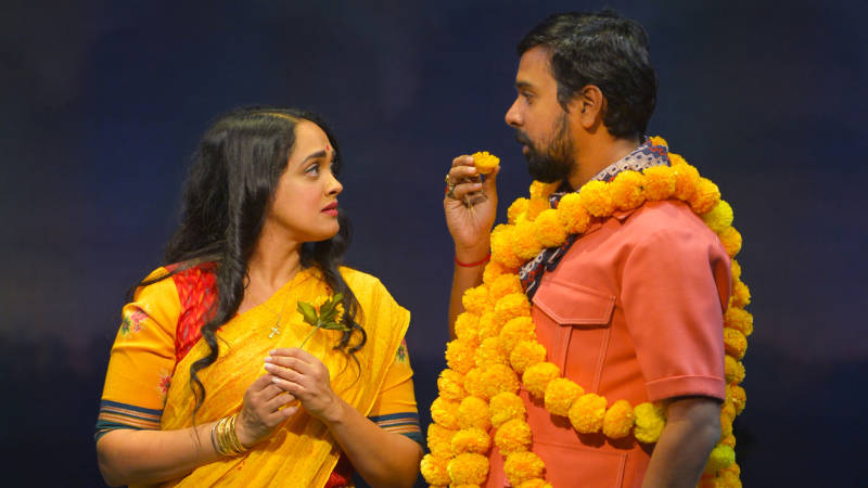 The Wedding Planner Dubey (Namit Das) and the woman of his dreams Alice (Anisha Naagarajan) in Mira Nair's musical theater adaption of her hit film, 'Monsoon Wedding' at the Berkeley Rep.