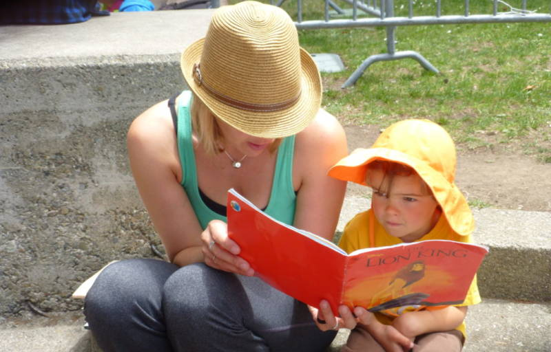 Mom and child reading at last years Bay Area Book Festival