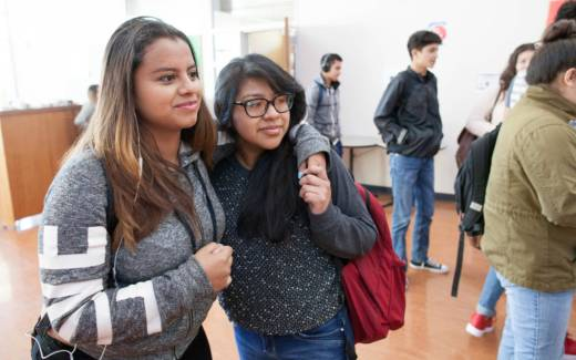 Alejandra (right), an undocumented high school student in Oakland, with a friend.