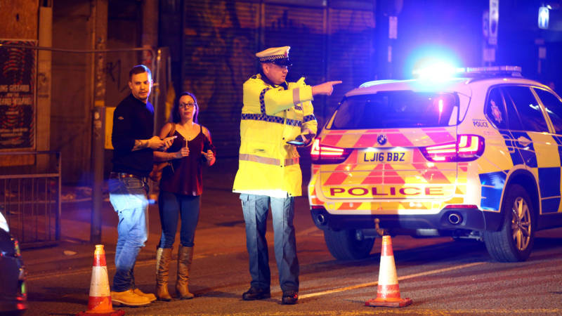 A street close to England's Manchester Arena is cordoned off Monday, as police confirm fatalities after a concert there by Ariana Grande. Media quote witnesses as saying there was an explosion and the audience ran for the exits.