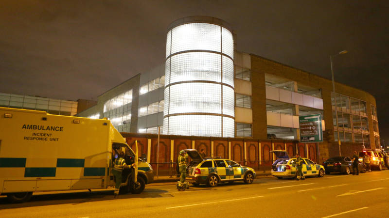 Emergency services arrive close to the Manchester Arena on Monday after reports of explosions following an Ariana Grande concert.