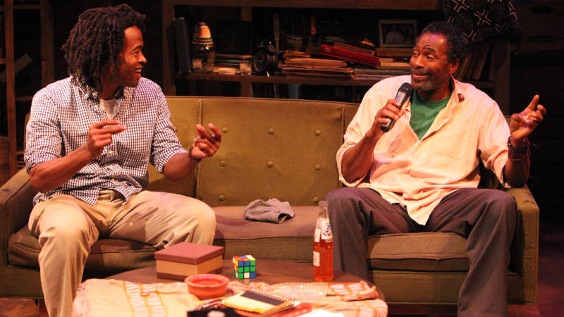 (L to R) Journalist Steve Barron (Rafael Jordon) and Gil Scott-Heron (Carl Lumbly) lay down a rap about Fanta soda in 'Grandeur' by Han Ong.
