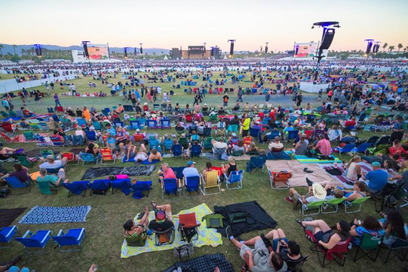 A crowd slowly fills the Polo Fields at Indio for the Desert Trip music festival.