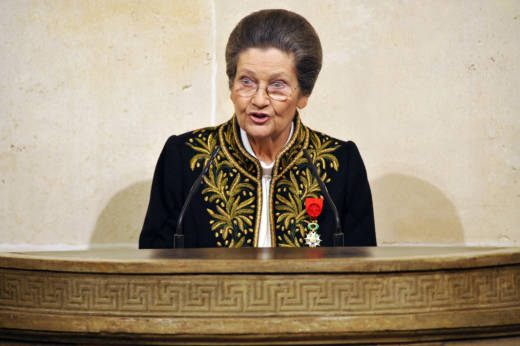 """French Simone Veil, an Auschwitz survivor and the first elected president of the European parliament, delivers a speech as she joined today the prestigious Academie Francaise, the guardian of the French language, on March 18, 2010 at the Institut de France in Paris. The 82-year-old Veil, a former French minister who ranks among the country's most respected politicians, was only the sixth woman to join the """"immortals"""", as the 40 members of the Academie are known. Dressed in the members' traditional green uniform, designed specially for her by Chanel, Veil was presented with the ceremonial sword bearing the inscription """"Liberty, Equality and Fraternity"""". Veil's tattooed Auschwitz prisoner number, 78651, was also engraved on the sword that was presented to her by former president Jacques Chirac during a ceremony at the French Senate."""