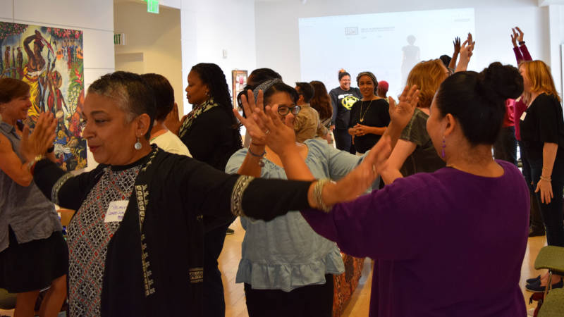 Participants in the Rise Up! workshop at the Museum of the African Diaspora run an exercise on June 24, 2017.