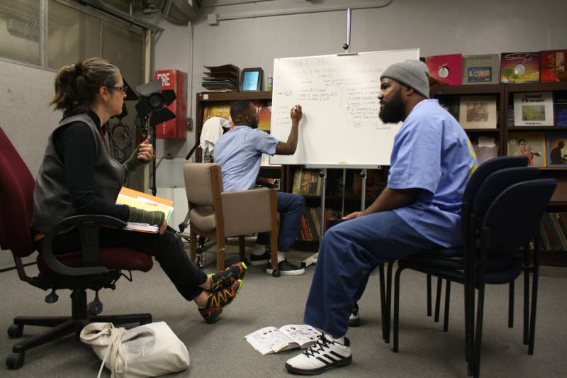 Nigel Poor, Antwan Williams and Earlonne Woods in a story pitch session at San Quentin, 2017.