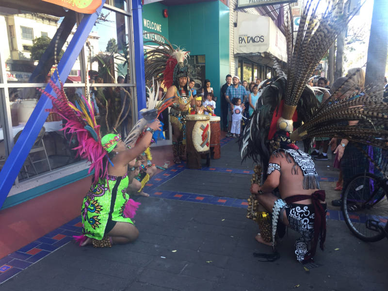Dancers performing in front of the Mission Cultural Center for Latino Arts