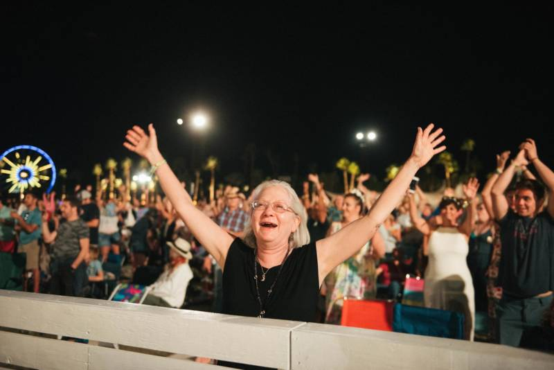 A woman takes in the music at Desert Trip in Indio, Calif., in 2016.