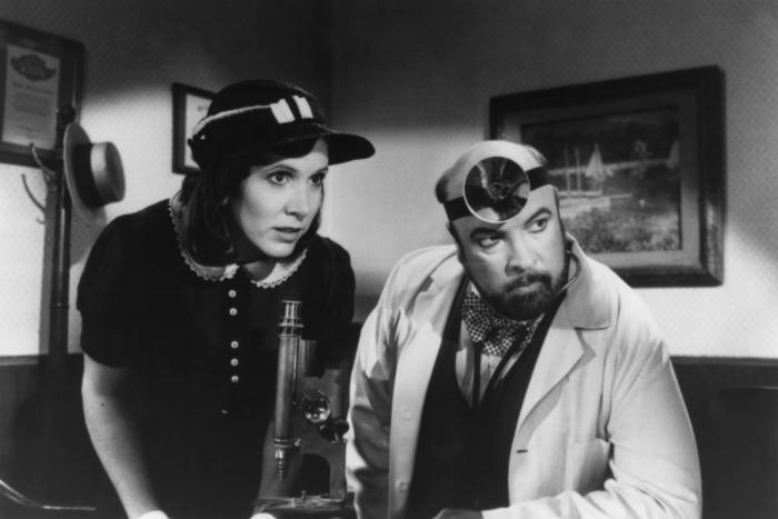 Carrie Fisher and Paul Bartel in 'Amazon Women on the Moon,' 1987.