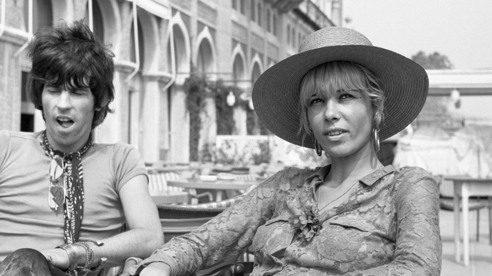Anita Pallenberg, sitting outside the Excelsior Hotel in Venice alongside Keith Richards in1967