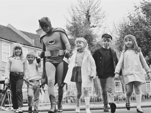 Adam West, dressed as Batman for the filming of a 1967 road safety ad for children.