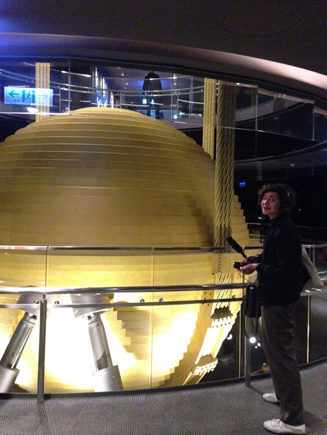 Trufelman recording at the tuned mass damper atop Taipei 101, a device that reduces the amplitude of mechanical vibrations in the building.