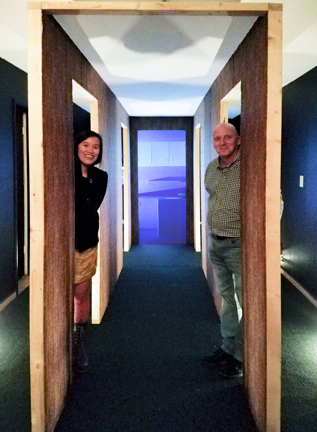 Amy M. Ho with collaborator Dennis Crookes standing inside installation for 'Spaces From Yesterday: The Hallway' at Oakland's Royal NoneSuch Gallery.