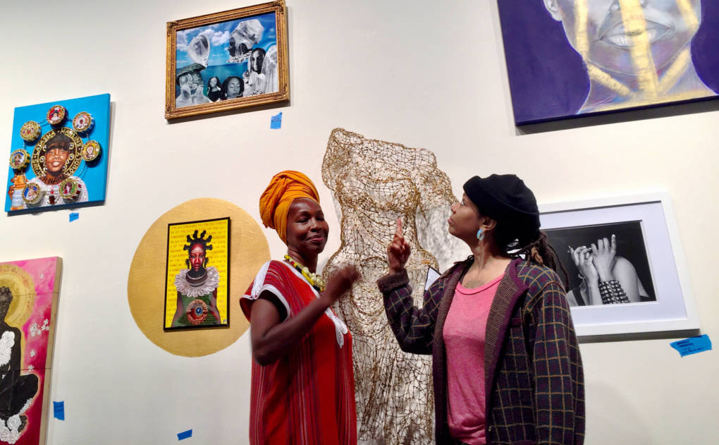 Karen Seneferu and Melora Green co-curators for The Black Woman is God exhibition at SOMArts in San Francisco