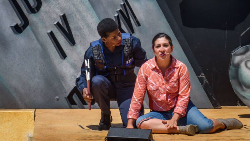 Just depicting L. Mary Jones (Velina Brown) and Zaniyah Nahuati (Marilet Martinez) together is dangerous for Breitbart News in 'Walls' by the San Francisco Mime Troupe.