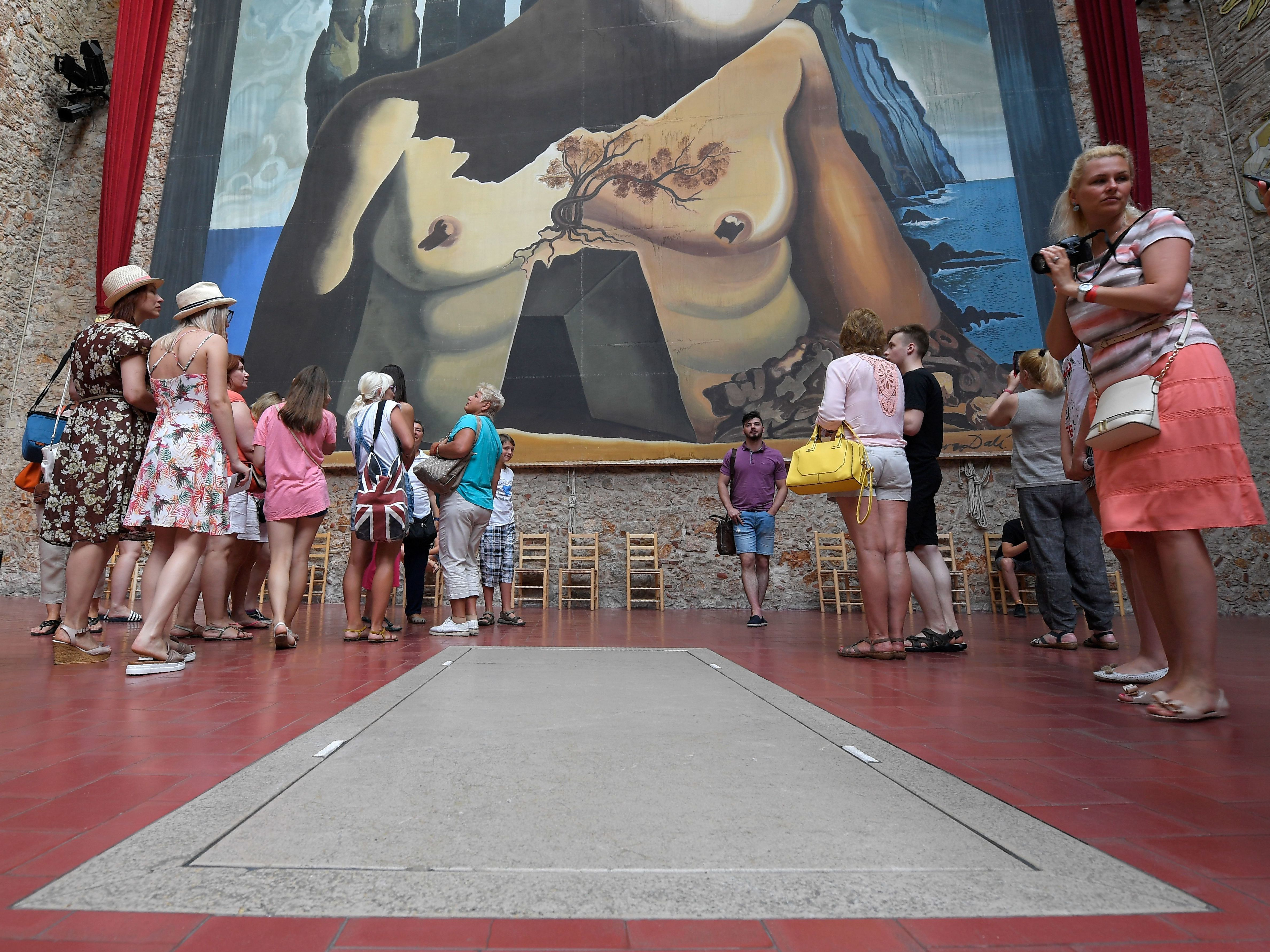 Tourists visit Salvador Dali's tomb at the Dali Museum Theater in Figueres on Friday, following the exhumation of his remains