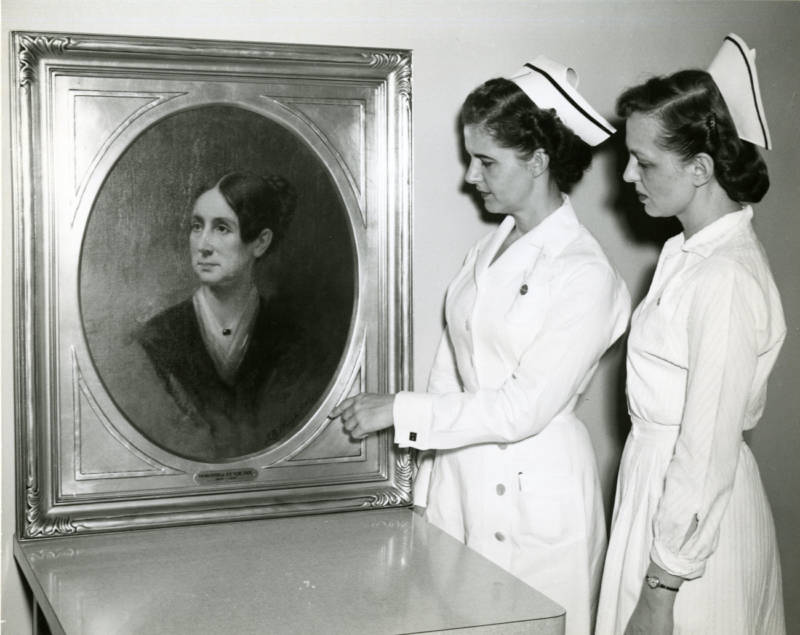 St. Elizabeths nurses in the 1950s study a portrait of Dorothea Lynde Dix, a 19th century social reformer. Dix helped found the treatment facility in the 1850s.