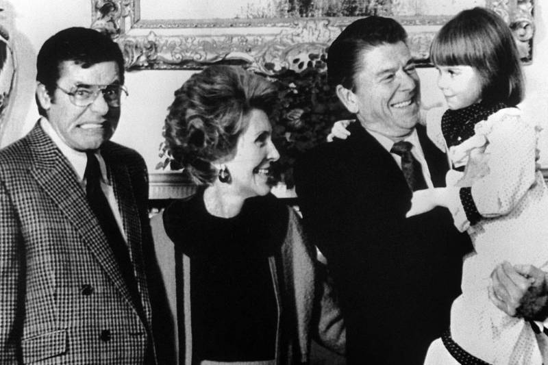 Lewis makes a face in 1981 as President Reagan and his wife, Nancy, receive Christi Bartlett, a child who was suffering from muscular dystrophy.