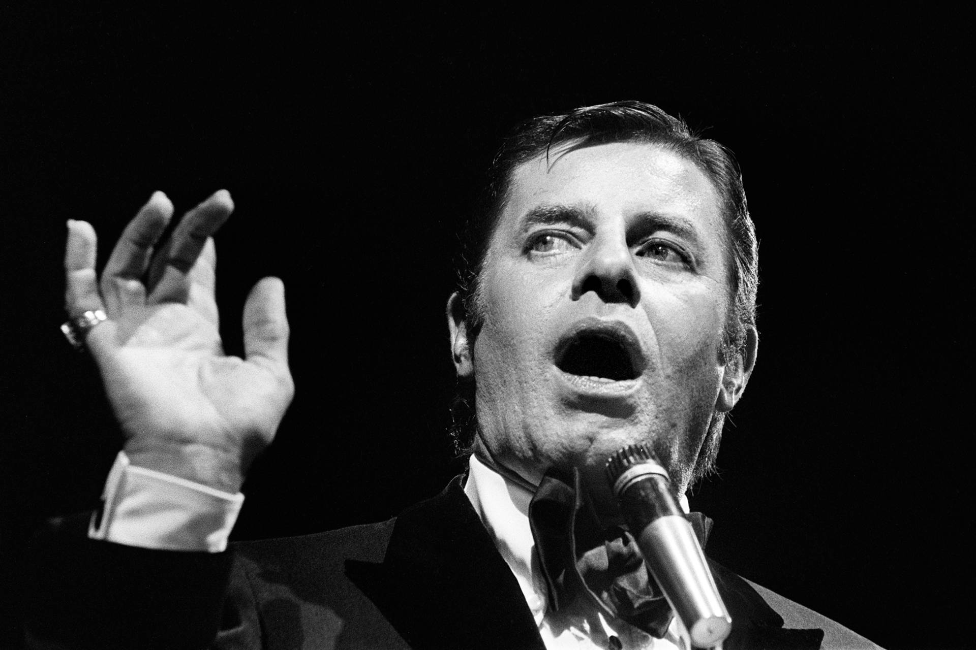 Jerry Lewis performs in Paris in 1976. Lewis, who appeared in dozens of films throughout his career, was perhaps nowhere more critically acclaimed than in France, where he earned the country's highest civilian honor. Photo: STF/AFP/Getty Images