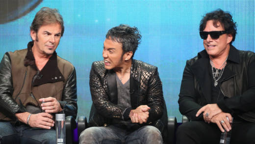 "(L-R) Keyboardist Jonathan Cain, lead vocalist Arnel Pineda and guitarist Neal Schon speak onstage during the ""Don't Stop Believin': Everyman's Journey"" panel at the PBS portion of the 2013 Summer Television Critics Association tour at the Beverly Hilton Hotel on August 6, 2013 in Beverly Hills, California."