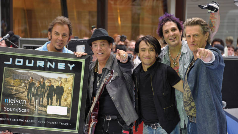 (L-R) keyboard player Jonathan Cain, guitar player Neal Schon, singer Arnel Pineda, drummer Deen Castronovo, and bass player Ross Valory of the band Journey performs at the 2011 Today Summer Concert series at Rockefeller Plaza on July 29, 2011 in New York City.