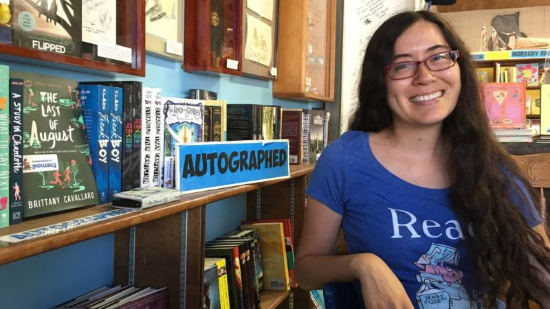 "Suzi Hough manages Hicklebees, a San Jose children's bookstore. She takes in stride the arrival of a new bookstore a 15 minute drive away. ""If Amazon's here, it helps promote literacy, and that's important to us."""
