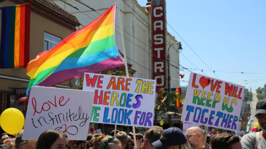 Signs at the Come Together rally in San Francisco's Castro District